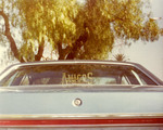 Amigos Car Club: Photograph of 1977 Ford LTD owned by Arturo Zorro Herrera; depicts Amigos Car Club plaque in rear window; photo taken at the Dairy Queen parking lot, around the corner of Beyer Blvd and Coronado Ave in South Bay