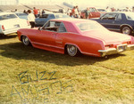 "Amigos Car Club: Photograph of 1964 Buick Riviera (""Pink Panther"") owned by Victor ""Buzz"" Muñoz"