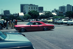 "Amigos Car Club: Photograph of 1964 Buick Riviera (""Pink Panther"") owned by Victor ""Buzz"" Muñoz at a ""hop"" at the county administration building in downtown San Diego"