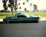 "Amigos Car Club: Photograph of 1959 Chevrolet Impala (""Azteca"") owned by Rigo Reyes, at Del Sol Park in South Bay"