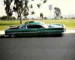 "Amigos Car Club: Photograph of 1959 Chevrolet Impala (""Azteca"") owned by Rigo Reyes, at Del Sol Park in South Bay"