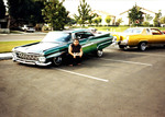 "Amigos Car Club: Photograph of 1959 Chevrolet Impala (""Azteca"") owned by Rigo Reyes, and a candy gold 1978 Cadillac owned by Gaspar Martinez"