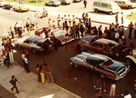 Brown Image Car Club: Photograph of a lowriding car show at Chicano Park