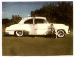 Chicano Brothers Car Club: Photograph of David Aguilar with a 1952 Chevrolet