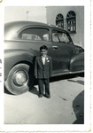 Chicano Brothers Car Club: Photograph of David Aguilar's brother, Sam, with car in 1955