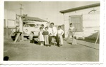 Chicano Brothers Car Club: Photograph of David Aguilar with his father Francisco, cousin Ruth, brother Josue, and brother Efrem