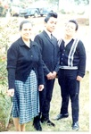 Chicano Brothers Car Club: Photograph of David Aguilar with his mother Magdalena and brother Josue