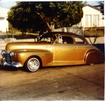 City Car Club: Photograph of a 1941 Oldsmobile on Highland Avenue