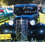 Domestic Rides Car Club: Photograph of a 1938 Chevrolet at a car show at Chicano park