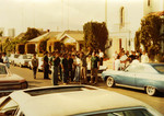Korner Car Club: Photograph of Korner Car Club members outside of Our Lady Guadalupe Church during the annual blessing of the cars by Father Brown