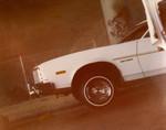 "Korner Car Club: Photograph of a white Gran Torino ""hopping"""