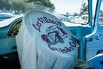 Los Villanos Car Club: Photograph of Los Villanos Car Club jacket displayed at Lowrider Council event at Mission Bay