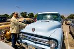 Los Villanos Car Club: Photograph of Los Villanos Car Club member Gilbert Ochoa with vehicle at Lowrider Council event at Mission Bay