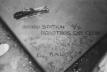 Nosotros Car Club: Photograph of club members' names engraved in cement at Barrio Station