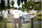 Oldies Car Club: Photograph of car club members wearing Oldies t-shirts