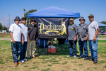 Pachuco Car Club: Photograph of Pachuco Car Club members with banner at Lowrider Council event at Mission Bay