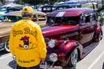 Serra Car Club: Photograph of Serra Car Club member Mathias Ponce at Lowrider Council event at Mission Bay