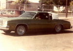 Specials Car Club: Photograph of Jovita Juarez with a 1979 Oldsmobile Cutlass Supreme